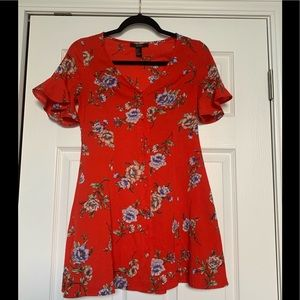 F21 red flowy mini dress with flower detail.